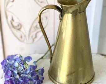 A stunning vintage English brass water pitcher