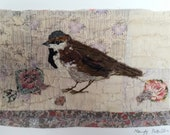 Unframed appliqued sparrow with embroidery on to vintage quilt fragment