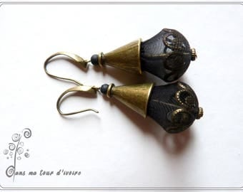 Pretty earrings textile black, lava rock and bronze.