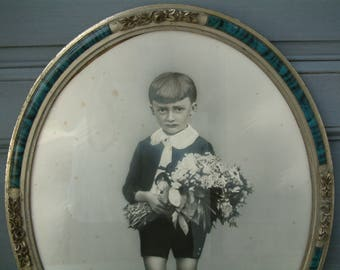 Antique french silvertone photo portrait of a little boy holding flowers. Blue with silver flowers oval art deco frame. French nordic decor