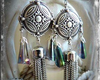 long earrings, all silver.