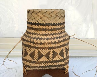 Vintage hand weaved basket with wood base