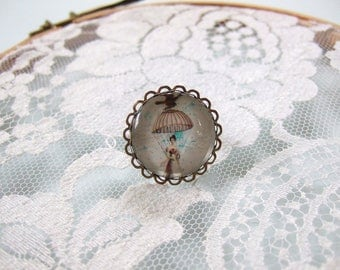 Ring cabochon round woman with umbrella