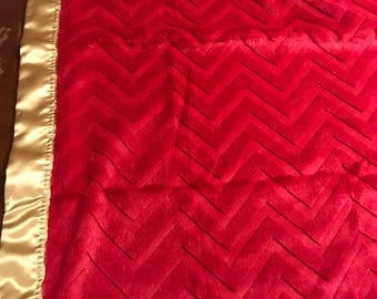 29 x 35 red chevron embossed minky with gold satin backing and binding