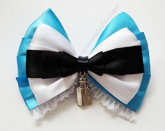 Alice In Wonderland Inspired Bow With Drink Me Dangling Embellishment