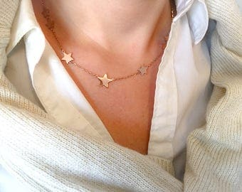 Rose necklace with stars of various sizes