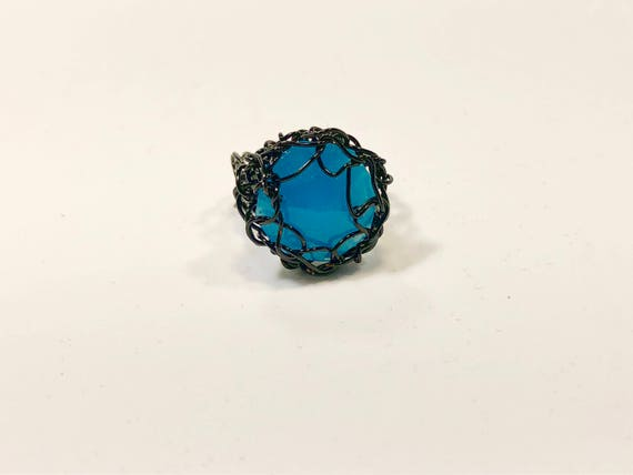 Handmade black wire crochet ring with blue chandelier crystal prism