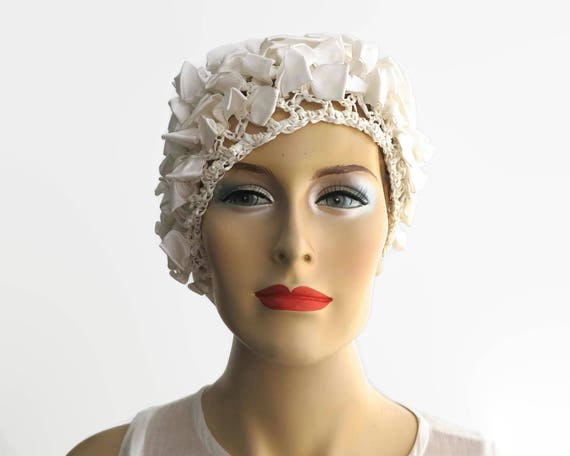 Vintage hat, ivory color, open weave straw covered with ribbon bows, beret style, very stretchy, uncrushable, will fit any head, circa 1960s