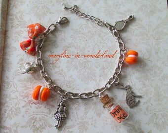 """alice in Wonderland country"" orange charm bracelet"