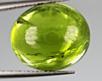 13.45ct top green color,Oval cut peridot Cabochon From Pakistan.