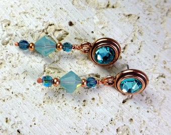 Eye catching Copper & Swarovski Crystal Drop Post Earrings.   Zircon Blue and Swarovski Pacific Opalite Crystal Dangle Earrings.