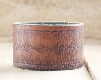 CUSTOM HANDSTAMPED distressed brown leather cuff with design by mothercuffer