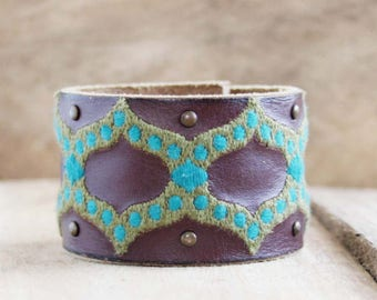 CUSTOM HANDSTAMPED brown leather cuff with blue green design by mothercuffer
