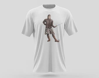 Arya Stark T-shirt Design of Young Stark Wolf from the Game of Thrones Television Series shown on HBO. Arya Stark Holding her Needle  shirt