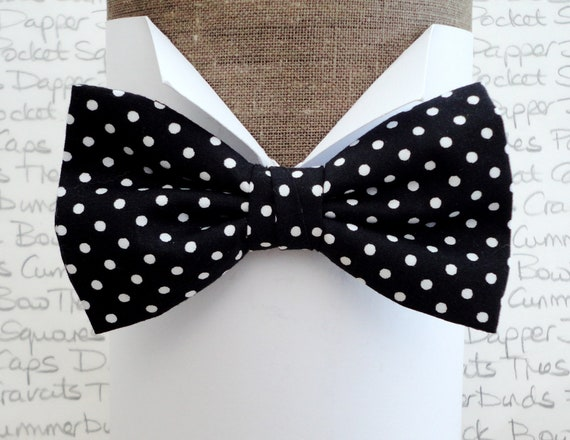 "Bow tie pre tied or self tie, black with white spots, will fit neck size upto 20"" (50cms)"
