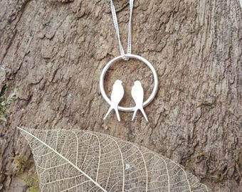 Sterling silver swallows at rest pendant