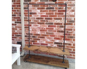 Garment rack with bottom shelf. Industrial Clothing Rack for clothes and shoe storage.  Store fixture.