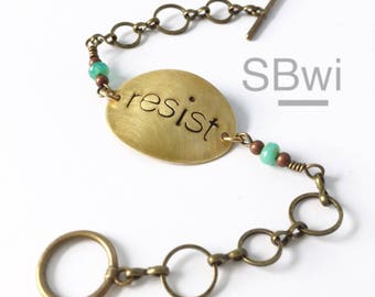 Resist bracelet with turquoise in bronze picasso glass detail