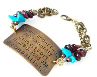 You are imperfect, permanently and inevitably flawed * and you are beautiful bracelet in bronze with turquoise and garnet detail