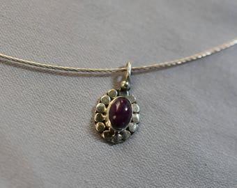 Purple carnelian oval pendant on silver wire