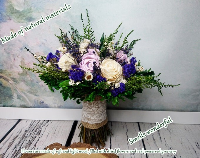 Natural bridal bouquet in purple and green with preserved greenery and dried lavender