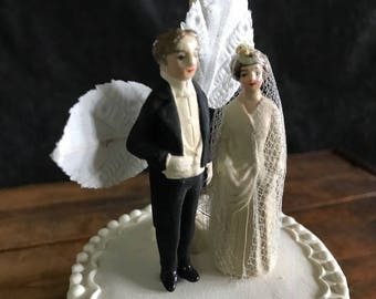 Antique bride and groom cake topper