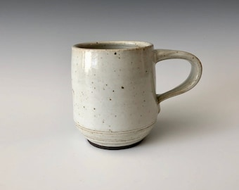 Modern handmade pottery coffee cup/mug matte white over black clay Haight Pottery Company