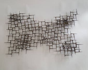 abstract metal wall sculpture of bronze and nails