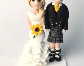Polymer clay personalised wedding cake topper. Groom and bride