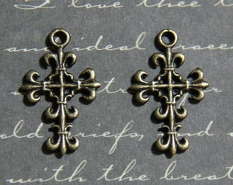3 delicate cross bronze 14x23mm