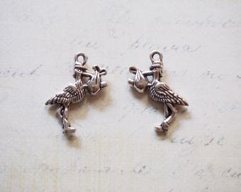 2 charms Stork and bundle baby silver-plated 24x17mm