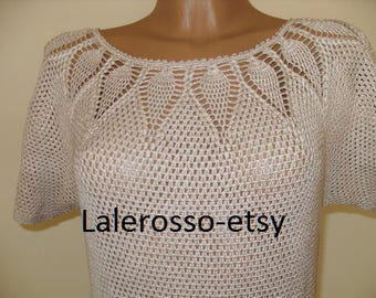 Hand-knit dress with no seams.Ivory color