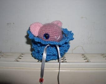 Pink kitten in her crochet bag