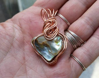 Red Abalone shell pendant.  Wire wrapped in copper wire.