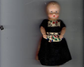 celluloid doll with open and close eyes ,wearing wooden shoes 1930
