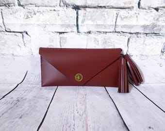 Burgundy leather clutch bag.
