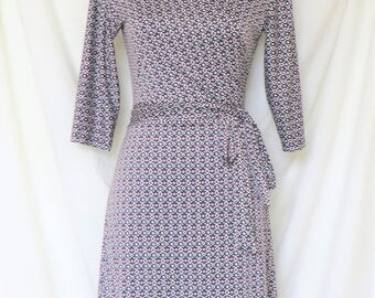 Zoey -  Wrap dress with 3/4 length sleeves and A-line knee-length skirt