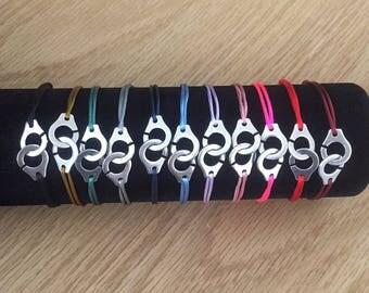 Bracelet menottes sur cordon. Style Dinh Van