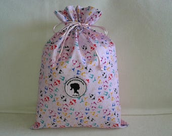 Multicolored bikinis on my bag of summer with a pink and white gingham backing