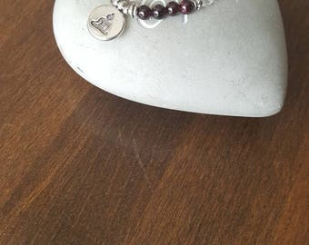 Garnet, rock crystal and lava stone stretch bracelet, Buddha.