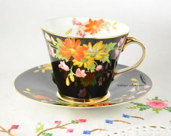 Black Aynsley cup and saucer, hand painted colorful flowers