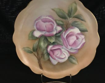 Handpainted Porcelain Plate in a Floral Motif and artist signed Mildred Fugua.  10-1/4''  (CGP-1910N)