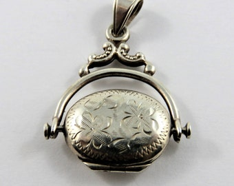Vintage Mechanical Double Picture Locket that Spins Around and Around Sterling Silver Charm or Pendant.