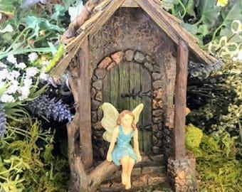 Miniature Fairy in Doorway