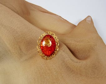Red ring, golden ring , glass cabochon , golden support ,adustable ring, hand-made.