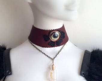 Alice in WastelandS steampunk vial choker necklace with snake shed.