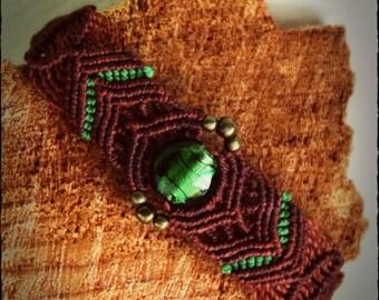 Macrium bracelet with green glass bead