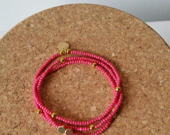 chic and colorful bracelet with hot pink and gold seed beads with Golden sequin charms: gold and pink