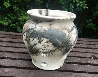 Orchid pot decorated with horse hair and feathers