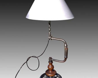 Drill, crankshaft, lamp on base metal